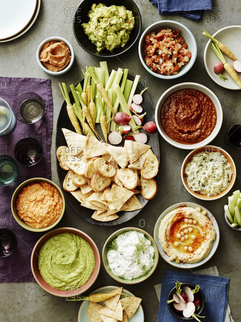 Overhead of various party snacks and dips