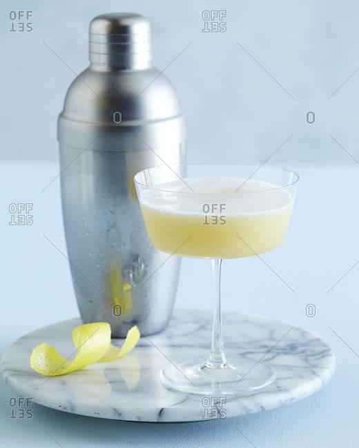 Filibuster cocktail and cocktail shaker on platter