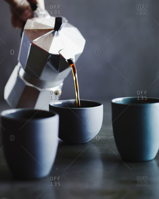 Coffee poured into cups from moka pot