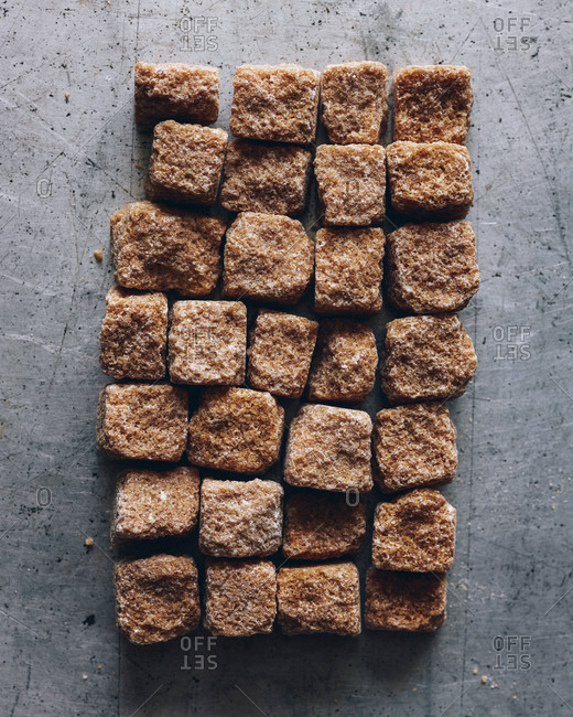 Raw sugar cubes arranged into rectangle