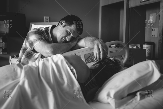 Man comforting his wife in labor