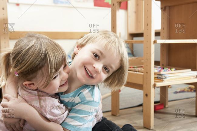 Little girl and little boy rampaging in kindergarten