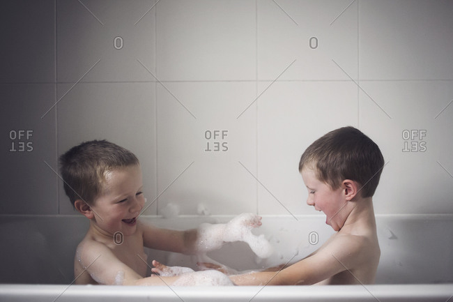 Brothers having a bubble bath