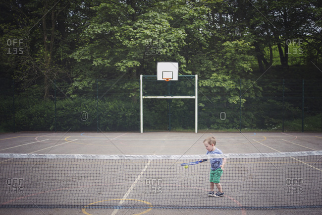 Young boy playing on a court