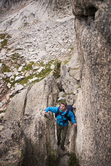 Mountain climber in crevice, Wind River Range
