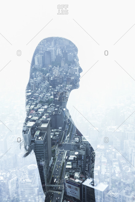 Reflection in window of woman