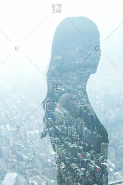 Reflection in window of woman in profile