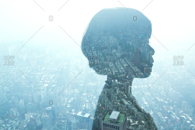 Profile of a woman overlayed on a city