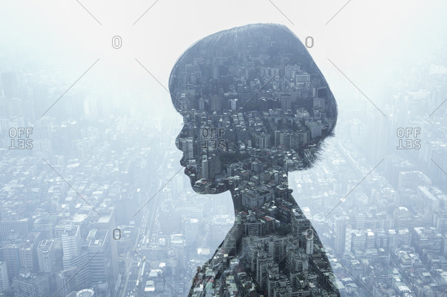 Profile view of a woman and city