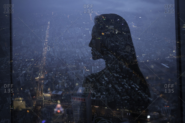 Profile of a woman and city at night