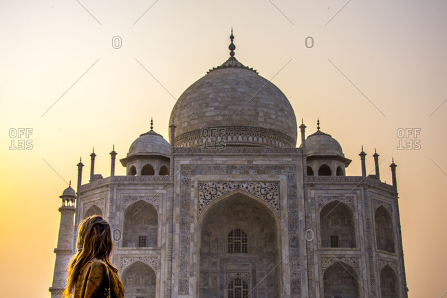 A woman stares at the Taj Mahal