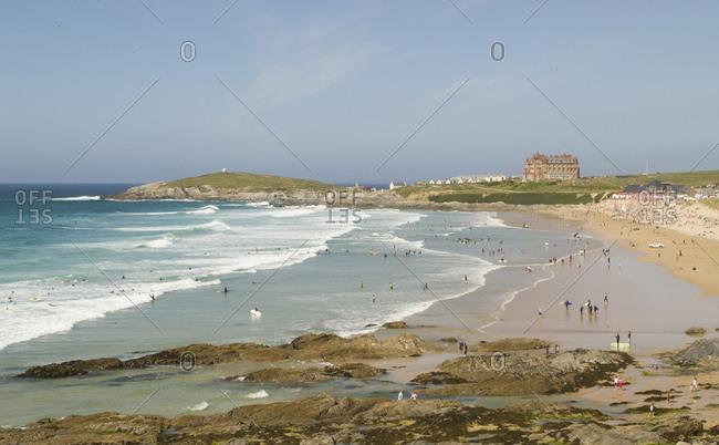 Surfers gather on a beach