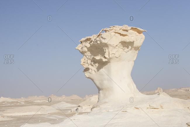 A rocky plateau rises in the desert
