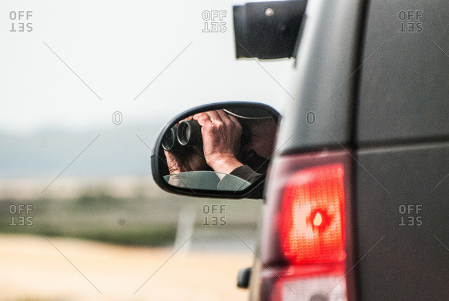 Reflection of a binocular in a side view mirror