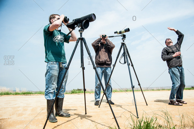 - May 11, 2013: Ornithologists looking trough binoculars in a field