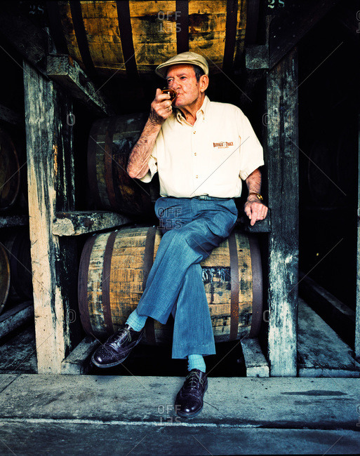 Frankfort, Kentucky - February 25, 2012: Master Distiller Elmer T. Lee takes a sip of his favorite bourbon.