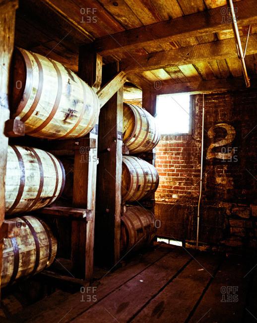 Barrels of bourbon aging in wooden barrels
