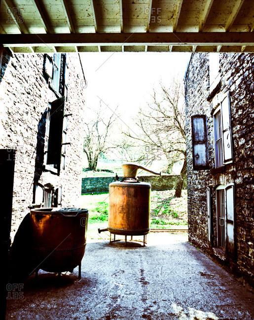 Old copper distiller on display at a distillery