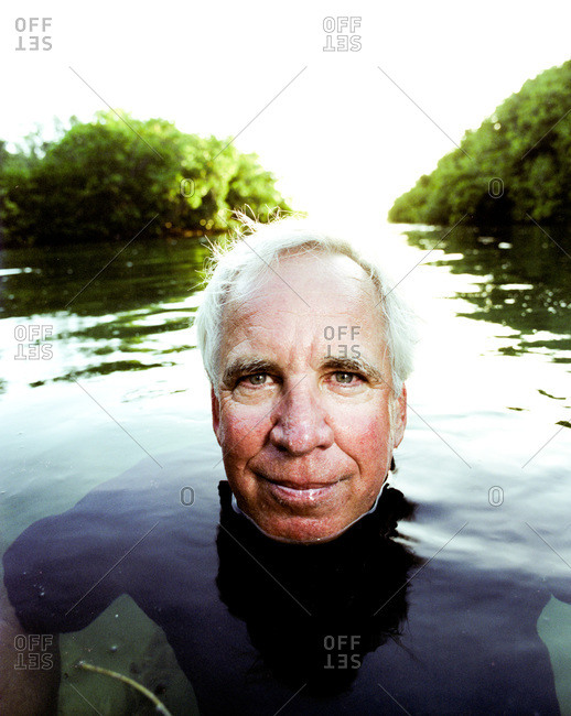 Key West, Florida - February 20, 2012: Portrait of fishing guide Jeffrey Cardenas in the water