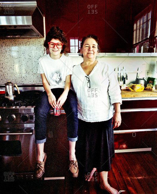 New Orleans, Louisiana - February 26, 2012: Karen Gadbois, founder of The Lens, with her daughter in their kitchen