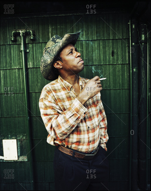 Memphis, Tennessee - February 1, 2012: Head Pit master, Henry, taking a smoke break outside of Rendezvous