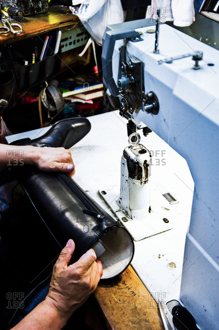 Shoemaker sewing a boot