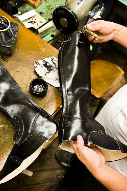 Shoemaker polishing leather boots