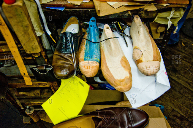 Shoes and shoe trees in a shoemaker's workshop