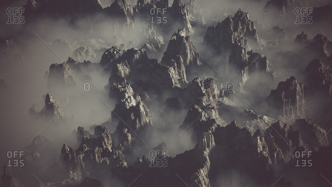 Aerial of rocky gray mountain landscape in the clouds