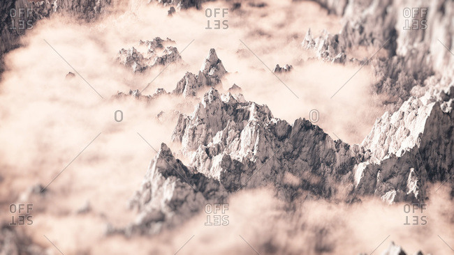 Aerial snow mountain landscape in the clouds