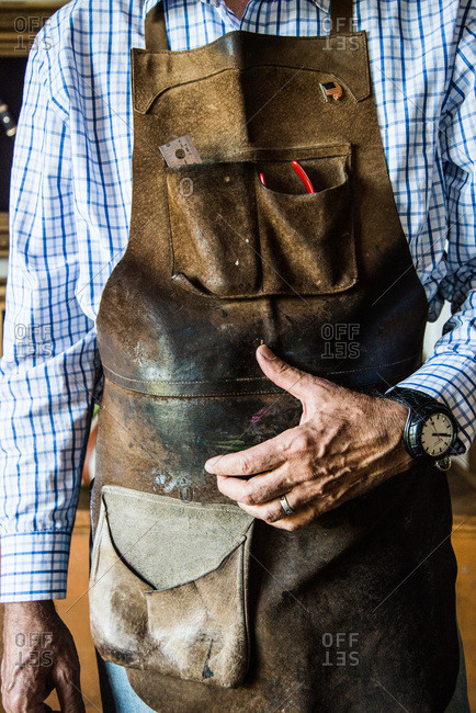 Leather craftsman wearing an apron