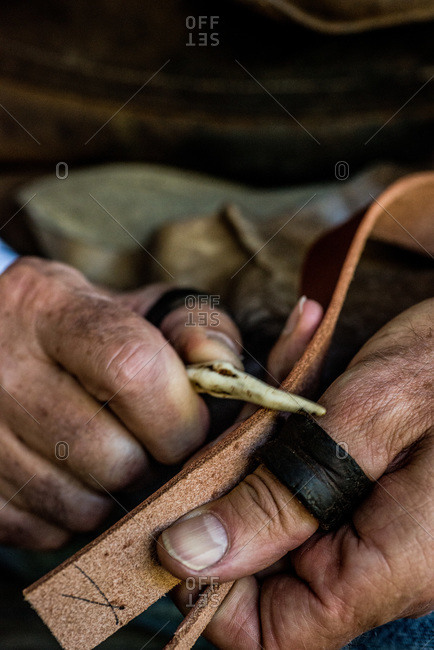 Artisan shaping a piece of leather