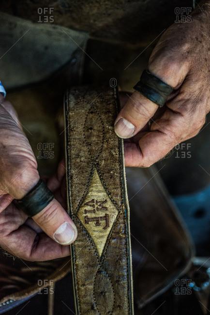 Artisan showing a handmade leather belt