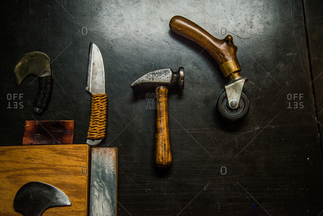 Leathercraft hand tools on a tabletop