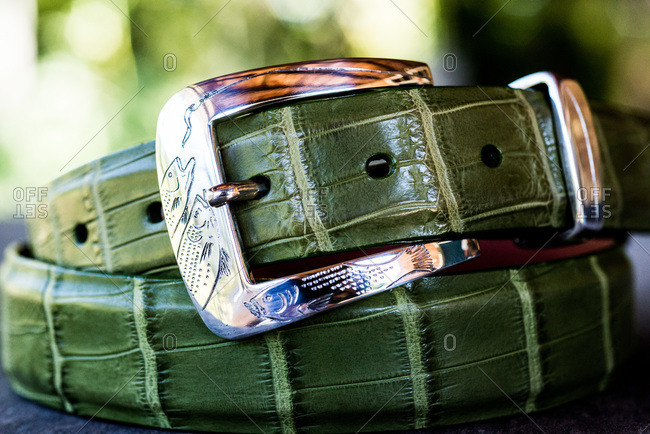 Close up of a green leather belt