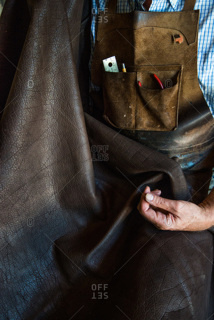 Artisan holding a piece of leather