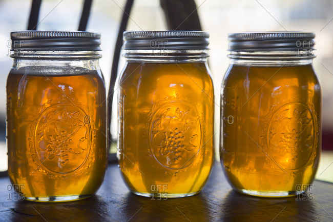 Three jars of honey for sale at country market