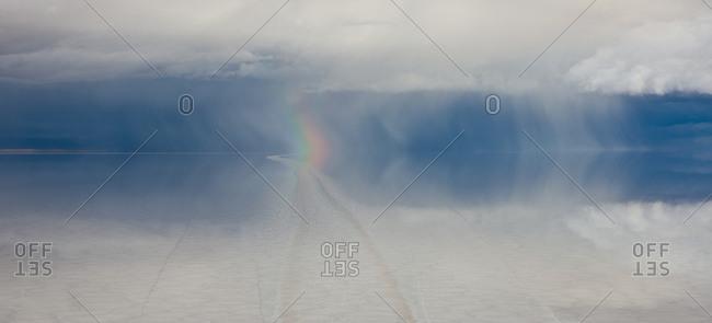 Rainbow over Salar de Uyuni, a salt flat in Bolivia