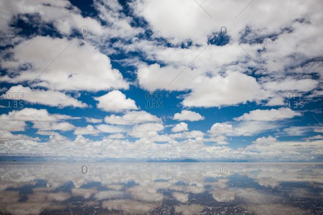 Clouds reflecting in a salt lake at Salar de Uyuni, Bolivia