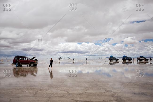 Salar de Uyuni, Bolivia - February, 1, 2010: Tourists at the world's largest salt flat