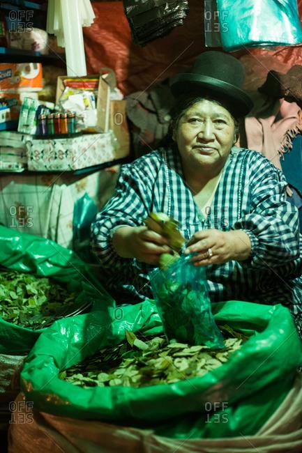 La Paz, Bolivia - February 25, 2010: Woman selling coca leaves at La Paz market