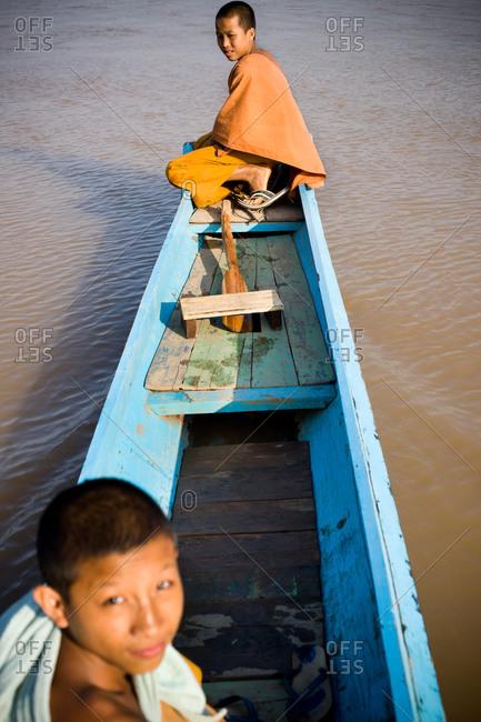 Luang Prabang, Laos - November 1, 2009: Buddhist boys in boat on water