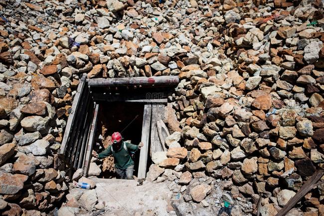 Miner at mine entrance