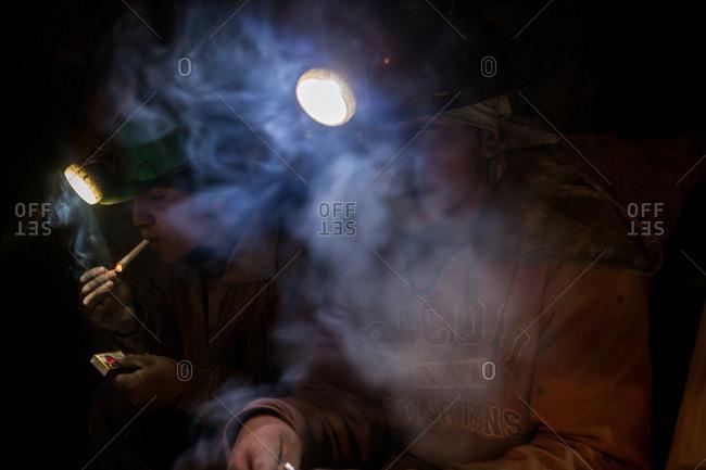Potosi, Bolivia - February 4, 2010: Miners smoking underground