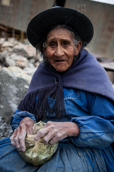 Potosi, Bolivia - February 6, 2010: Elderly woman with bag of coca leaves