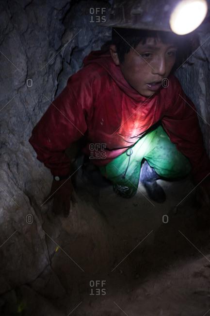 Potsi, Bolivia - February 8, 2010: A child miner works inside the mine