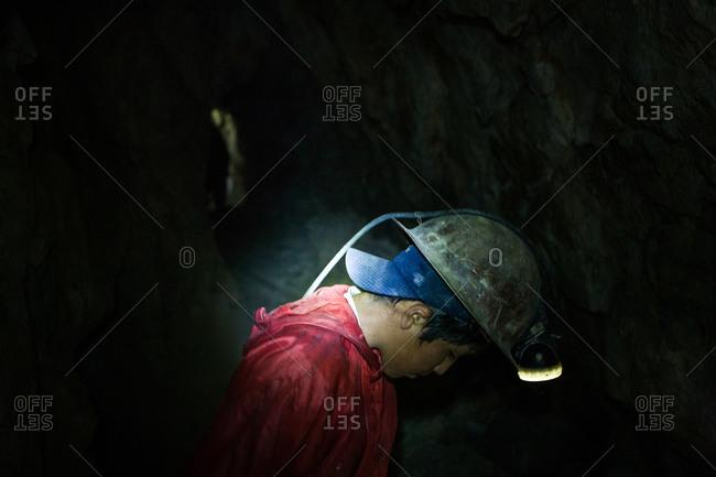 Potsi, Bolivia - February 8, 2010: Young boy working  inside mine