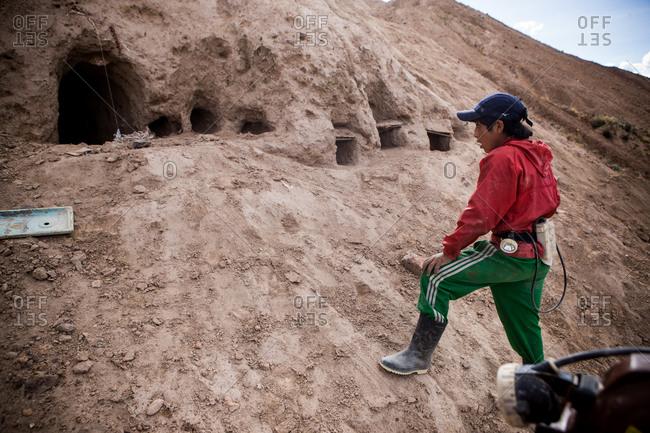 Potsi, Bolivia - February 8, 2010: Bolivian boy working as a miner