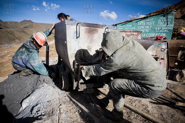 Potsi, Bolivia - February 9, 2010: Bolivian Miners pulling a minecart