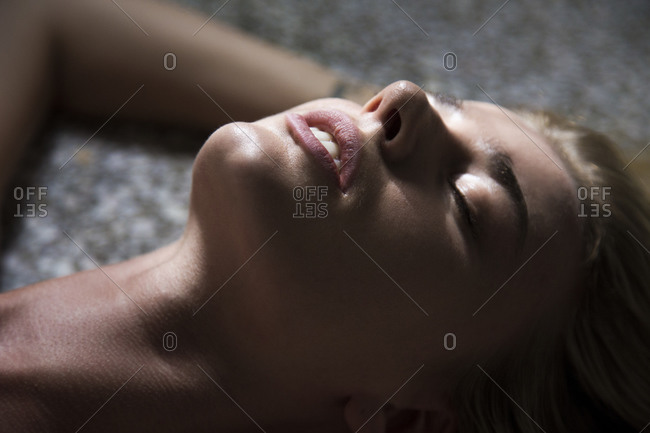 Close up of woman's face laying down